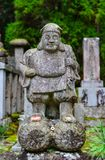 A God statue on Mount Koya in Japan. A God statue on Mt. Koya in Wakayama, Japan. Mount Koya Koya-san in Japanese is one of Japan most sacred mountains Royalty Free Stock Photography