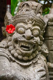 God statue at the temple in Kuta, Bali, Indonesia.  Stock Photos