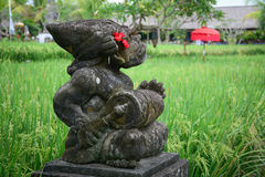 God statue at the village in Bali, Indonesia Stock Photos