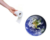 God telling earth to clean itself up. Hand offering toilet paper to planet earth isolated on white background. Some components of this montage are provided Royalty Free Stock Photo