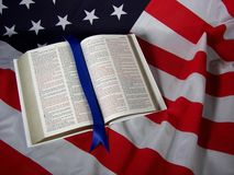 Open Bible on American flag Stock Photos