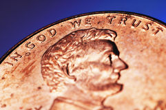 In God we Trust. Close up shot of a penny bearing our nation's motto royalty free stock photo