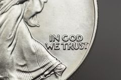 In God We Trust. The motto on a United States coin Royalty Free Stock Image