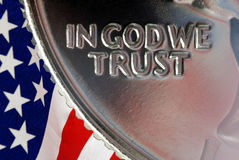 In God We Trust. Red, White, and Blue From American Flag Reflected in God We Trust Motto on Vintage, Retro, 1967 United States Quarter Stock Photography