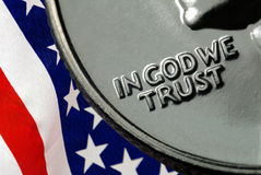 In God We Trust. On 1967 United States Quarter over American Flag Royalty Free Stock Photos