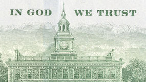 In God We Trust plus Independence Hall hundred dollar bill. Close view of In God We Trust and Independence Hall on the back of an American hundred dollar bill Royalty Free Stock Photos