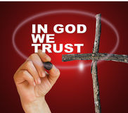 IN GOD WE TRUST. Writing word IN GOD WE TRUST with marker on gradient background made in 2d software Stock Photo