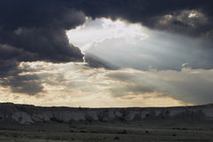 God Is Watching. Crepuscular rays light up the bluffs of Pawnee National Grassland in Colorado Royalty Free Stock Photography