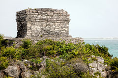 The God of Winds Temple in Tulum. The Ancient Mayan God of Winds Temple, guarding Tulum`s sea entrance bay in Quintana Roo, Mexico Stock Image