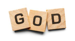 God Wood Tiles. God Spelled with Wood Tiles Isolated on a White Background royalty free stock photography
