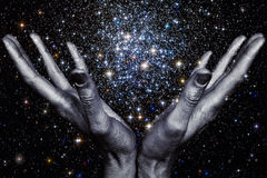 Gods hands holding a star galaxy Royalty Free Stock Image