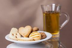 Goda dei biscotti con la cottura a vapore del tè caldo 1 Fotografie Stock Libere da Diritti