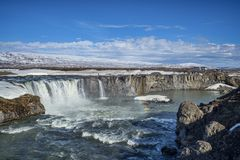 Godafoss, Famous Waterfall, Iceland. 15 April 2018: Godafoss, Iceland - Godafoss, the Waterfall of the Gods, a major tourist attraction in Iceland. A large party royalty free stock photography