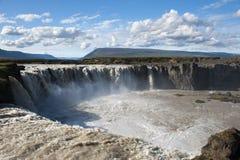Godafoss vattenfall med solig blå himmel, Island Arkivbild