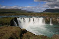 Godafoss waterfall, Iceland. Godafoss, 'Fall of the Gods', only 12 meters high but one of the most famous and beautiful falls in Iceland. With rainbow Royalty Free Stock Photos