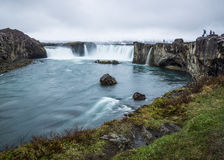 Godafoss waterfall Iceland. Tourists at Godafoss waterfall. Long exposure smooth water Royalty Free Stock Photos
