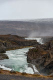 Godafoss Waterfall in Iceland. Water Spray and Moutain in Background. Stock Photos