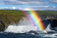 Godafoss waterfall and rainbow on a sunny day
