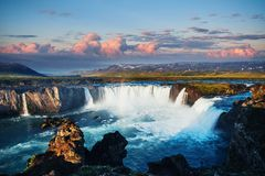 Godafoss waterfall at sunset. Fantastic landscape. Beautiful cumulus clouds. Iceland Royalty Free Stock Photos