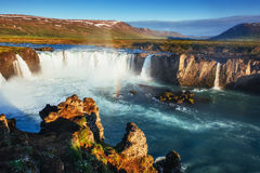 Godafoss waterfall at sunset. Fantastic rainbow. Iceland, Europe Royalty Free Stock Images
