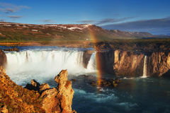 Godafoss waterfall at sunset. Fantastic rainbow. Iceland, Europe Royalty Free Stock Photography