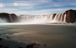 Godafoss waterfalls with mountain Royalty Free Stock Photos