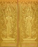 Goddess craft public temple door. Close up golden goddess hand craft on public temple door in Thailand Royalty Free Stock Image