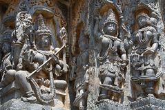 Goddess and dancers carved in Hoysaleshwara temple at Halebidu Royalty Free Stock Photos