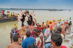 Goddess Durga idol is being immersed in holy river Ganges. KOLKATA, WEST BENGAL, INDIA - 30 SEPTEMBER 2017: Idol of Goddess Durga is being immersed in Holy royalty free stock photo