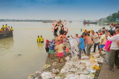 Goddess Durga idol is being immersed in holy river Ganges. KOLKATA, WEST BENGAL, INDIA - 30 SEPTEMBER 2017: Idol of Goddess Durga is being immersed in Holy royalty free stock photos