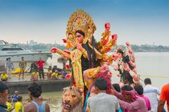 Goddess Durga idol is being immersed in holy river Ganges. KOLKATA, WEST BENGAL, INDIA - 30 SEPTEMBER 2017: Idol of Goddess Durga is being immersed in Holy stock images