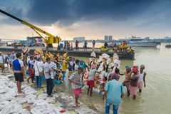 Goddess Durga idol is being immersed in holy river Ganges. KOLKATA, WEST BENGAL, INDIA - 30 SEPTEMBER 2017: Idol of Goddess Durga is being immersed in Holy Royalty Free Stock Photography