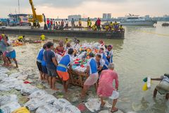 Goddess Durga idol is being immersed in holy river Ganges. KOLKATA, WEST BENGAL, INDIA - 30 SEPTEMBER 2017: Idol of Goddess Durga is being immersed in Holy royalty free stock images