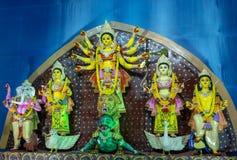 Goddess Durga idol at decorated Puja pandal, shot at colored light. royalty free stock photography
