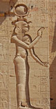 The Goddess Isis. A carving of the Egyptian goddess Isis at the Temple in Luxor, Egypt. This carving was defaced in ancient times stock image
