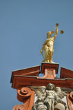 Goddess Justice. Golden statue of goddess Justice on top of building in Bad Waldsee, Germany royalty free stock images