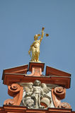 Goddess Justice. Golden statue of goddess Justice on top of building in Bad Waldsee, Germany Stock Photo