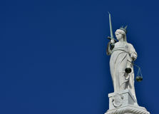 Goddess of Justice in Venice. Goddess of Justice statue with scales and sword, at the top of Doge Palace in Venice (with copy space&#x29 Stock Image