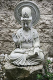 Goddess Kwan Yin sculpture Stock Photo