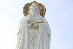 Goddess of mercy statue at seaside in nanshan temp Stock Photo
