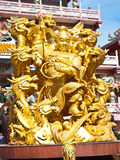 Goddess NaZha beating the dragon and china temple Stock Photo