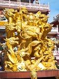Goddess NaZha beating the dragon and china temple Stock Photo