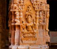 Goddess Tara - tantric meditation deity. Bas-relief of Goddess Tara, female Buddha. She is a tantric meditation deity. Sandstone carvings of column 12th century Royalty Free Stock Photography