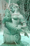 Goddess Water Fountain. Greek Parisian Water fountain of a mer woman holding a fish spraying water from it's mouth stock image