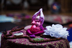 Goddesse on an altar. Surrounded by offerings Royalty Free Stock Photo