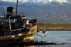 Goden Boat of Ushuaia at sunset royalty free stock image