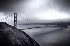 Goden Gate Splendor. The Golden Gate Bridge is caressed by sunlight as low clouds cover the Bay Area Stock Photos