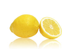 Goden one and a half lemons. One and a half lemons reflected and isolated on white background Royalty Free Stock Photo