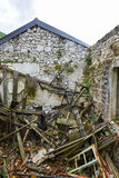 Crushed house in Godinje village at Montenegro. The ruined crushed and abandoned house in the Godinje village at Montenegro Stock Photo