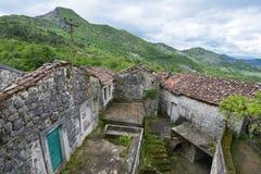 The Godinje village at Montenegro. The ruined and abandoned house in the Godinje village at Montenegro Stock Photos